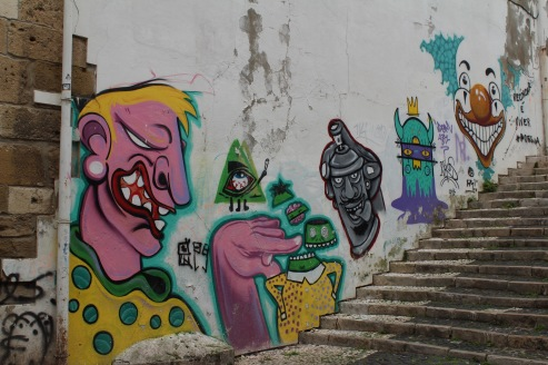Street art in the stairway up to the top of the hill.