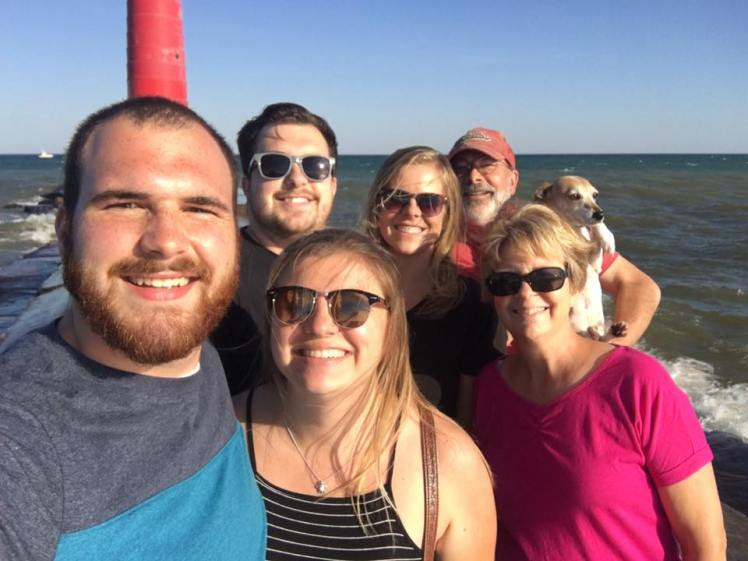 Family selfie in Sheboygan, Wisconsin by the lighthouse on Lake Michigan